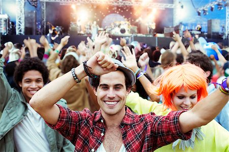 dancing - Portrait of fans dancing and cheering at music festival Stock Photo - Premium Royalty-Free, Code: 6113-07564830