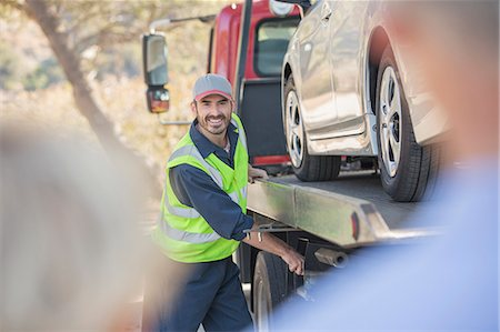 Roadside mechanic towing car for senior couple Stock Photo - Premium Royalty-Free, Code: 6113-07564950