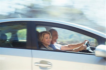 Happy senior couple driving in car Stock Photo - Premium Royalty-Free, Code: 6113-07564964