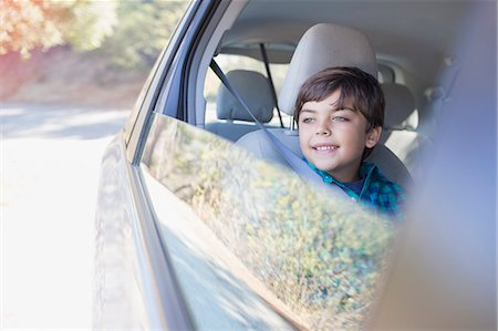 road trip - Happy boy looking out car window Stock Photo - Premium Royalty-Free, Code: 6113-07564971