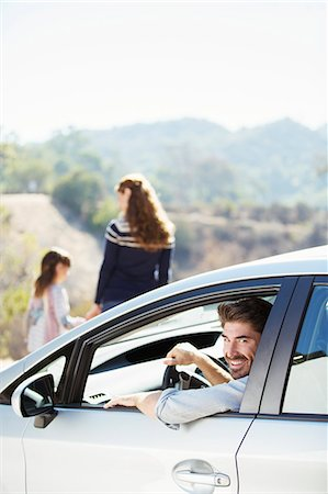 Portrait of happy man inside of car Stock Photo - Premium Royalty-Free, Code: 6113-07564974