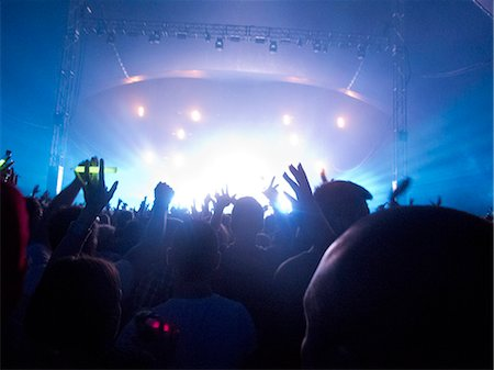 Silhouette of crowd facing stage at music festival Stock Photo - Premium Royalty-Free, Code: 6113-07564924