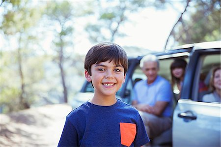 Portrait of smiling boy outside car Stock Photo - Premium Royalty-Free, Code: 6113-07565042