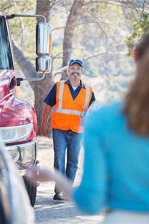 Roadside mechanic arriving to help woman Stock Photo - Premium Royalty-Free, Code: 6113-07565055