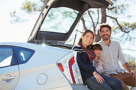 Portrait of happy family at back of car Stock Photo - Premium Royalty-Free, Code: 6113-07565064