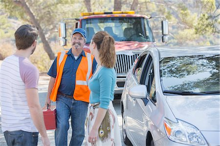 Roadside mechanic arriving to help couple Stock Photo - Premium Royalty-Free, Code: 6113-07565073