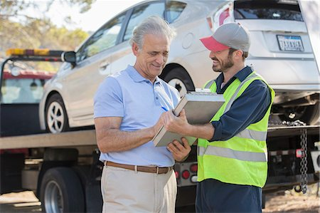 Roadside mechanic and man with paperwork Stock Photo - Premium Royalty-Free, Code: 6113-07565076