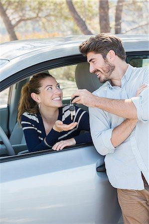 Man giving woman in car keys Stock Photo - Premium Royalty-Free, Code: 6113-07565080