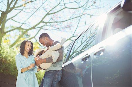 Happy family outside car Stock Photo - Premium Royalty-Free, Code: 6113-07565000
