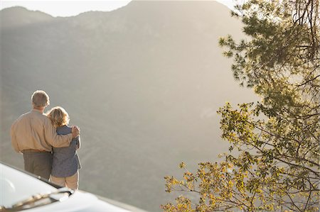 Senior couple looking at mountain view outside car Stock Photo - Premium Royalty-Free, Code: 6113-07565002