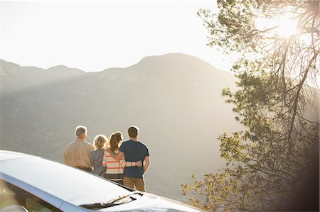 Family looking at mountain view outside car Stock Photo - Premium Royalty-Free, Code: 6113-07565018