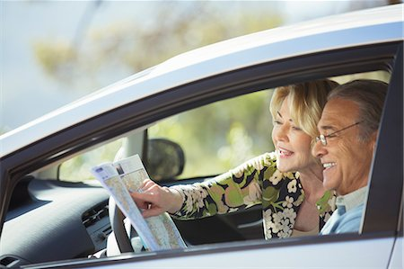 Senior couple looking at map inside car Stock Photo - Premium Royalty-Free, Code: 6113-07565024