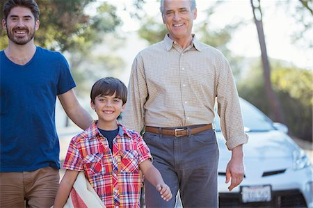 Happy multi-generation men outside car Stock Photo - Premium Royalty-Free, Code: 6113-07565109