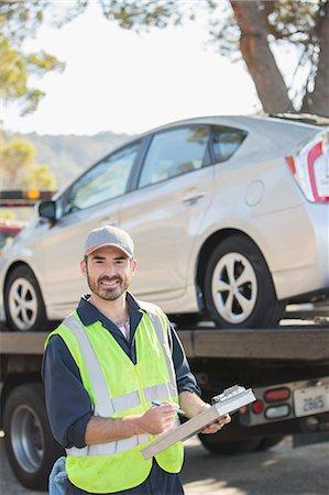 Portrait of confident roadside mechanic with paperwork Stock Photo - Premium Royalty-Free, Code: 6113-07565112