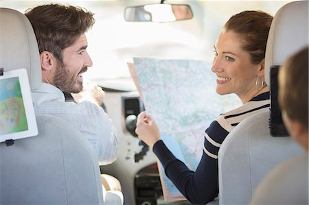 road trip - Family with map inside car Stock Photo - Premium Royalty-Free, Code: 6113-07565126