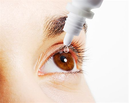 Extreme close up of woman putting eye drops into eye Stock Photo - Premium Royalty-Free, Code: 6113-07565281