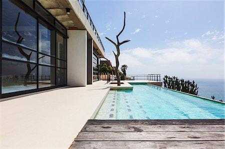 pool - Luxury lap pool overlooking ocean Stock Photo - Premium Royalty-Free, Code: 6113-07565229