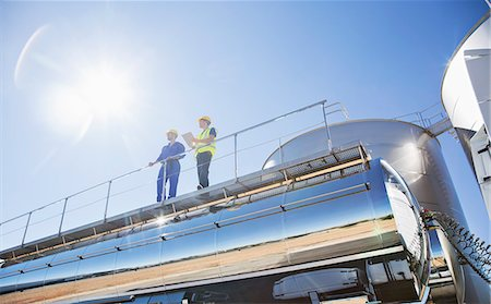 Workers on platform above stainless steel milk tanker Stock Photo - Premium Royalty-Free, Code: 6113-07565355