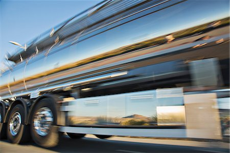 Blurred view of stainless steel milk tanker on the move Stock Photo - Premium Royalty-Free, Code: 6113-07565367