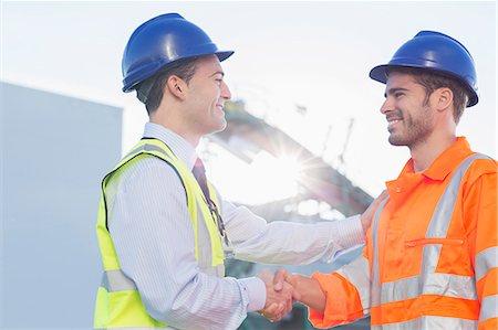 partnership - Businessman and worker handshaking Stock Photo - Premium Royalty-Free, Code: 6113-07565371