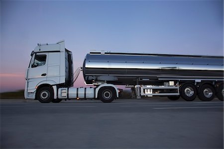 Stainless steel milk tanker on the road at night Stock Photo - Premium Royalty-Free, Code: 6113-07565383