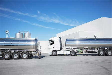 Stainless steel milk tankers parked Stock Photo - Premium Royalty-Free, Code: 6113-07565380