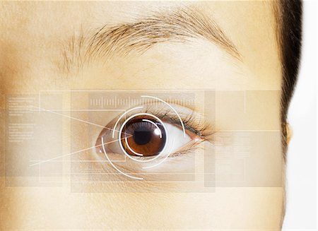 detail - Extreme close up of retina scan over brown eye Stock Photo - Premium Royalty-Free, Code: 6113-07565315