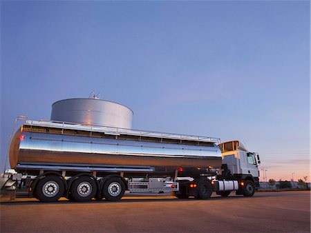 Stainless steel milk tanker next to silage storage tower Stock Photo - Premium Royalty-Free, Code: 6113-07565330