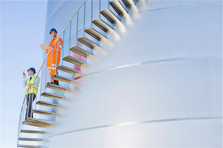 Workers on winding stairs along silage storage tower Stock Photo - Premium Royalty-Free, Code: 6113-07565337