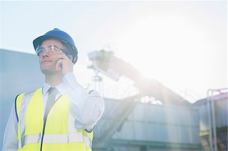 farm phone - Worker talking on cell phone at granary Stock Photo - Premium Royalty-Free, Code: 6113-07565338