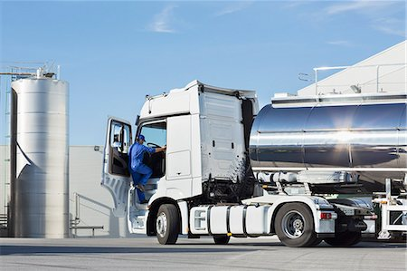 Truck driver climbing into stainless steel milk tanker Stock Photo - Premium Royalty-Free, Code: 6113-07565441
