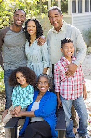 Portrait of smiling multi-generation family outdoors Stock Photo - Premium Royalty-Free, Code: 6113-07565475