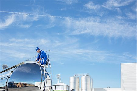 side view tractor trailer truck - Worker on top of stainless steel milk tanker Stock Photo - Premium Royalty-Free, Code: 6113-07565401