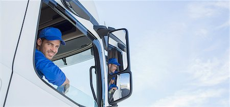 side view tractor trailer truck - Portrait of smiling truck driver leaning out window Stock Photo - Premium Royalty-Free, Code: 6113-07565419