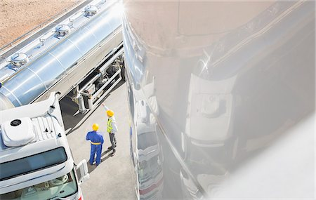Workers talking next to stainless steel milk tanker Stock Photo - Premium Royalty-Free, Code: 6113-07565421