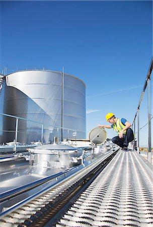 Worker on platform above stainless steel milk tanker Stock Photo - Premium Royalty-Free, Code: 6113-07565436