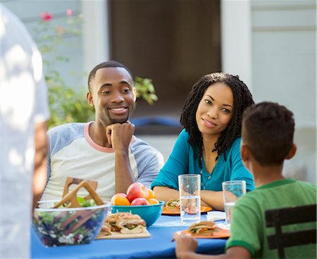 Family eating lunch at patio table Stock Photo - Premium Royalty-Free, Code: 6113-07565551