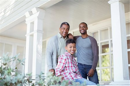 Portrait of smiling multi-generation men on porch Stock Photo - Premium Royalty-Free, Code: 6113-07565505
