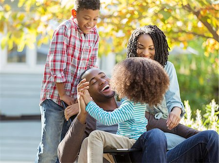 Happy family laughing outdoors Stock Photo - Premium Royalty-Free, Code: 6113-07565515