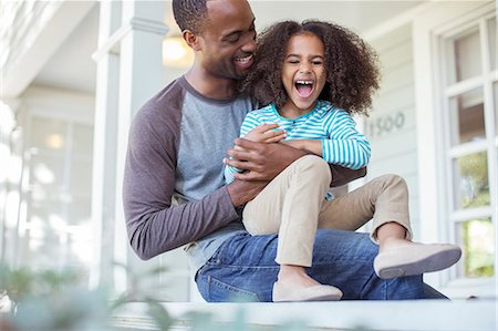 family  fun  outside - Father tickling daughter on porch Stock Photo - Premium Royalty-Free, Code: 6113-07565519