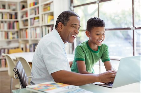 Grandfather and grandson using laptop Stock Photo - Premium Royalty-Free, Code: 6113-07565533