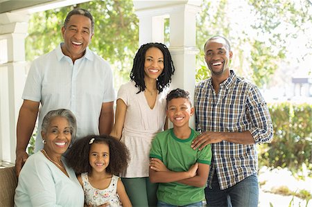 Portrait of smiling multi-generation family on porch Stock Photo - Premium Royalty-Free, Code: 6113-07565642