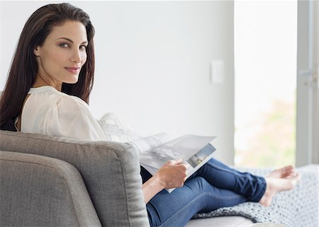 Portrait of confident woman reading magazine on chaise lounge Stock Photo - Premium Royalty-Free, Code: 6113-07565792