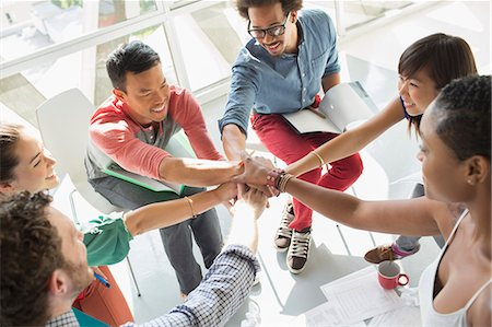 Creative business people connecting hands in huddle Stock Photo - Premium Royalty-Free, Code: 6113-07565856