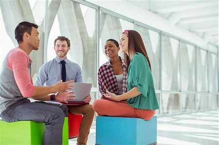 Creative business people meeting on colorful stools Stock Photo - Premium Royalty-Free, Code: 6113-07565878