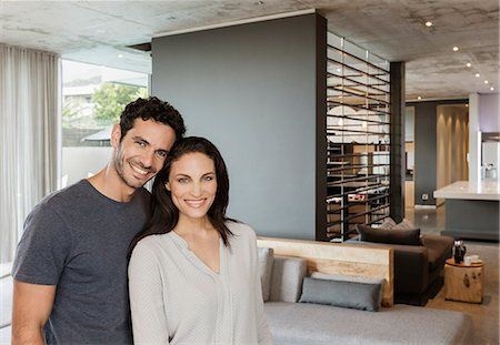 rich lifestyle - Portrait of happy couple in living room Stock Photo - Premium Royalty-Free, Code: 6113-07565818