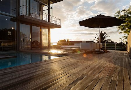 pool - Sun behind luxury house with swimming pool Stock Photo - Premium Royalty-Free, Code: 6113-07565824