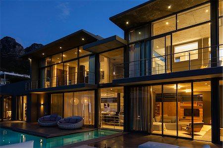 pool - Luxury house with swimming pool illuminated at night Stock Photo - Premium Royalty-Free, Code: 6113-07565833