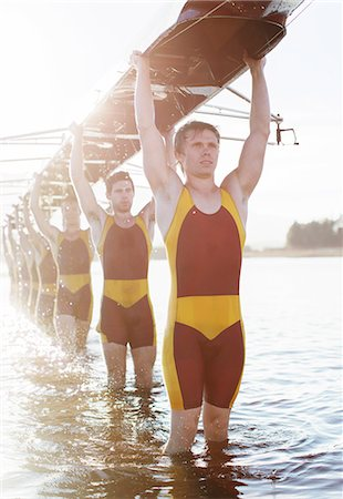 sport rowing teamwork - Rowing team carrying boat overhead on lake Stock Photo - Premium Royalty-Free, Code: 6113-07588643