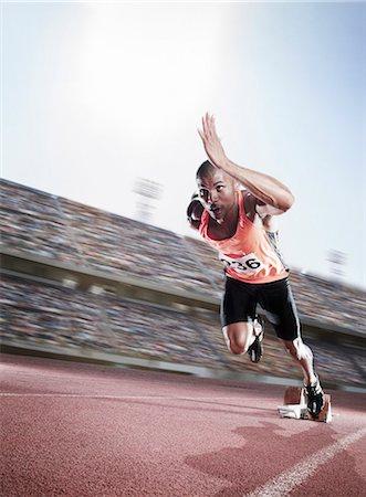 sprint - Sprinter taking off from starting block Stock Photo - Premium Royalty-Free, Code: 6113-07588645